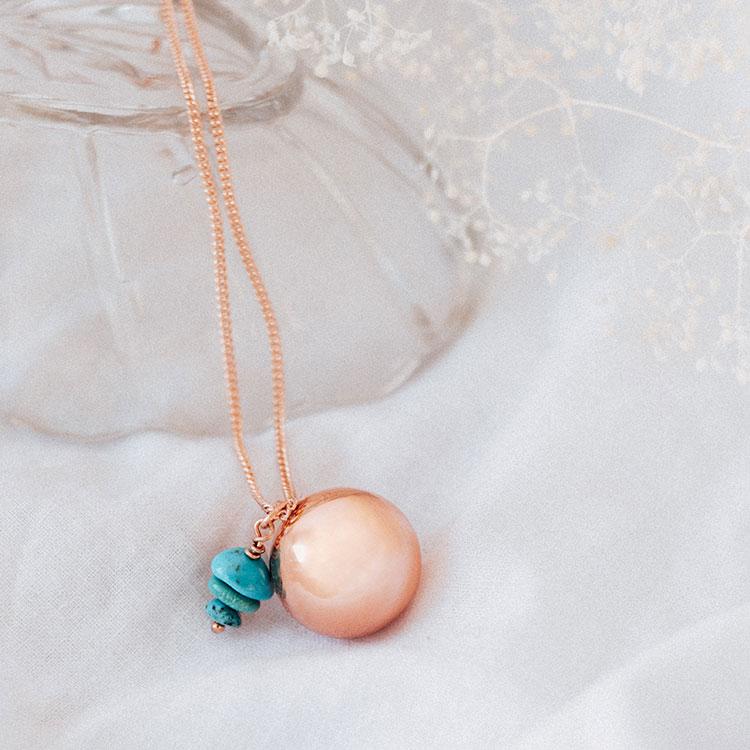 bola de grossesse avec pierre turquoise